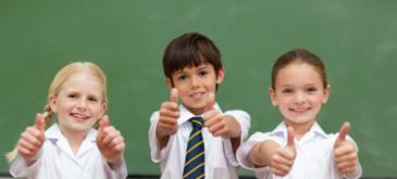 Thumbs up school children